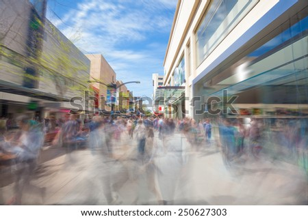 People walking along Rundle Mall in Adelaide, South Australia, with motion blur - stock photo