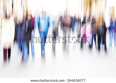 People walking around in the street - stock photo