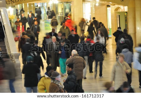 People walking in a train station. - stock photo
