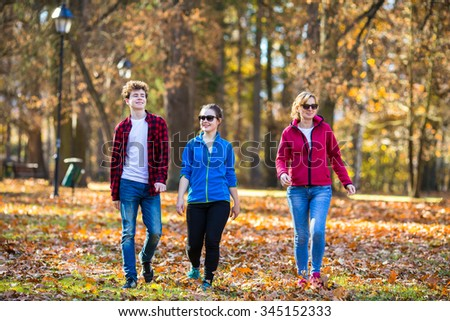 People walking in city park - stock photo