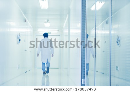 people walking in modern laboratory,abstract blur - stock photo