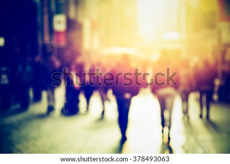 people walking in the street, blurry - stock photo