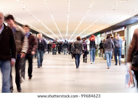 People walking - motion blur - stock photo
