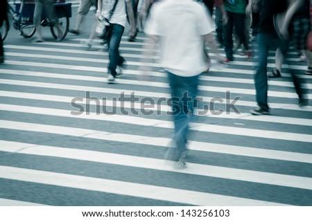 people walking on big city street - stock photo