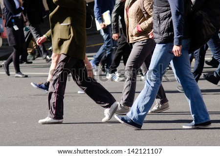 People walking on big city street, blurred motion crossing abstract - stock photo