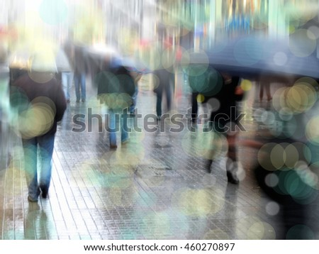 people walking on busy city street in rainy day - stock photo