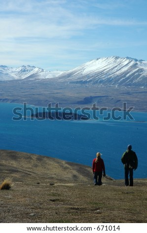 people walking on hill - stock photo