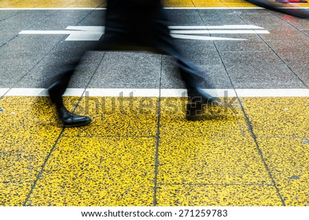 people walking on street - stock photo