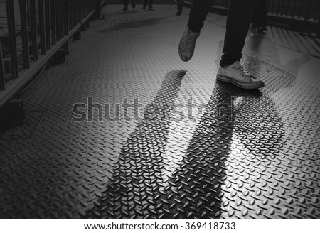 People walking on the overpass at night - stock photo