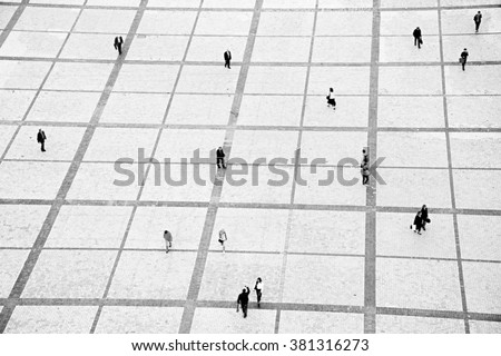 People walking on the Sofiyivsky square in Kiev, Ukraine. motion blur - stock photo