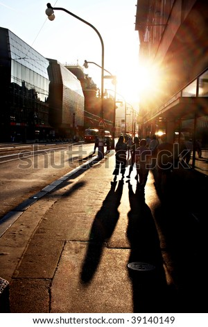 People walking on the street of Prague at sunset - stock photo