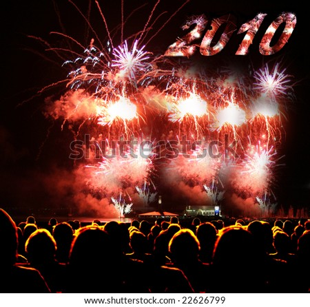 People watch fireworks display year 2010 - stock photo