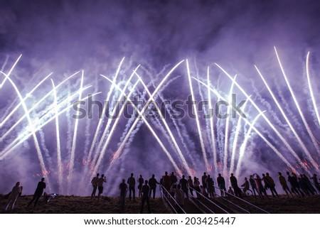People watching big beautiful fireworks - stock photo