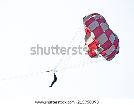 People with parachute. Parasailing  - stock photo