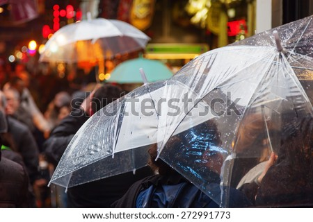 people with rain umbrellas at a bazaar in Istanbul, Turkey - stock photo