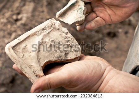 people with samples of archeology in the hands of - stock photo