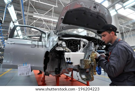 People work in the car factory in Lovech, Bulgaria, February 21, 2012 - stock photo