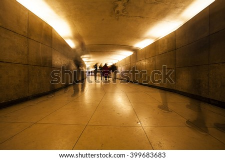 Peoples in underpass - stock photo