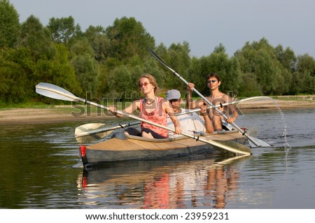 peoples travelling on canoe across the river - stock photo