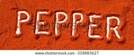Pepper in red pepper spice - stock photo