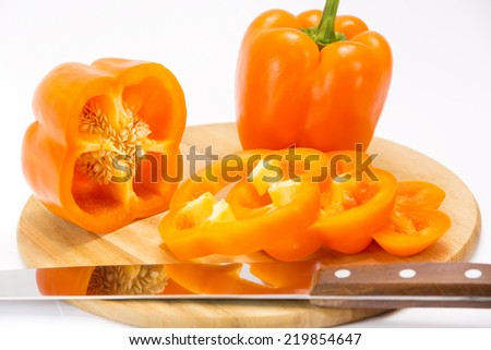pepper on a cutting board and knife - stock photo