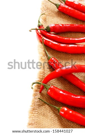 Pepper on an old fabric. - stock photo