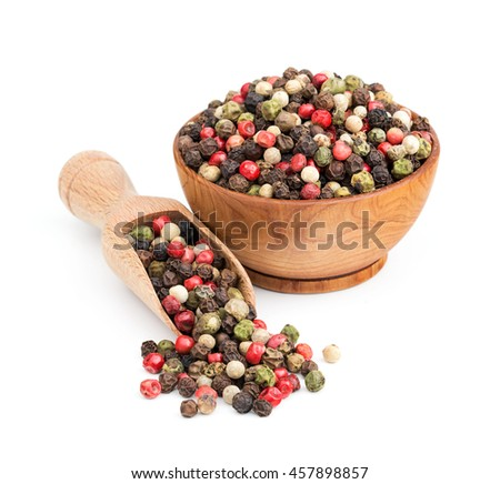peppercorn mix in a wooden bowl isolated on white - stock photo
