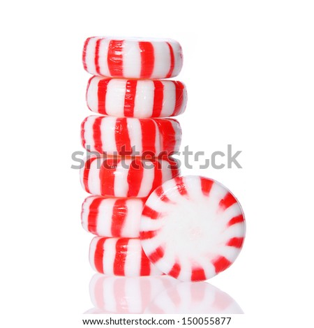Peppermint candy tower isolated on white. - stock photo