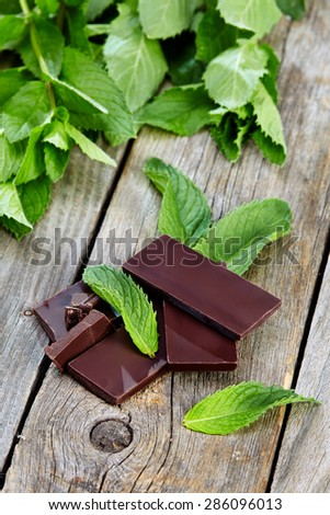 peppermint with chocolate on wooden table - stock photo