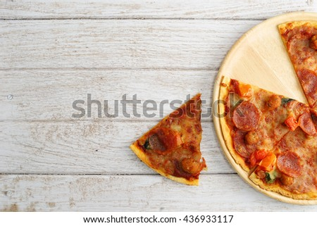 Pepperoni and Italian Sausage Pizza , Focus Selection - stock photo