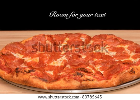 Pepperoni pizza on a pan with space for your text above - stock photo