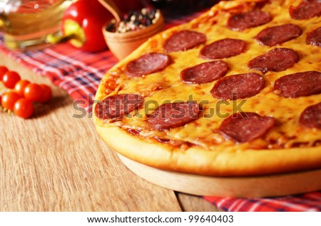 Pepperoni pizza  on the kitchen table - stock photo