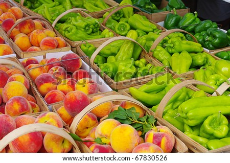Peppers and Peaches on Display at a Farmer's Market - stock photo