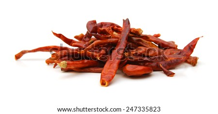 Peppers drying on a white background.  - stock photo