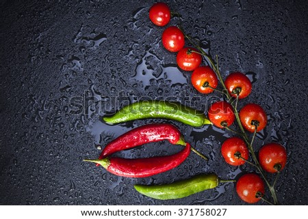 peppers on black slate - stock photo