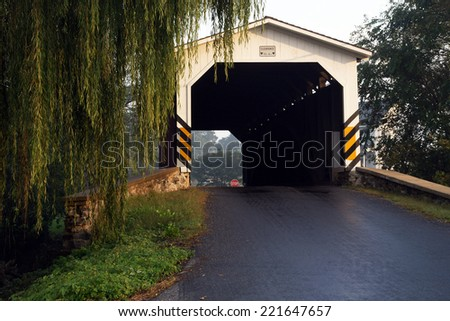 Pequea Creek Covered Bridge in Pennsylvania's  Amish Country near Lancaster,Pa. - stock photo