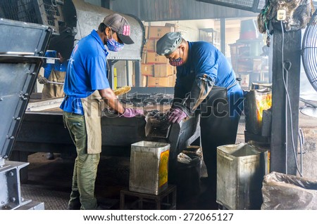 PERAK, MALAYSIA-APRIL 22: Aun Tong mill traditional coffeemaker worker at Taiping town on April 22, 2015 in Perak, Malaysia. This product is very popular for local market and also for export. - stock photo