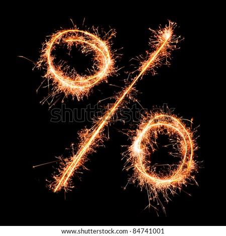 Percent sign. Real sparkler alphabet - stock photo