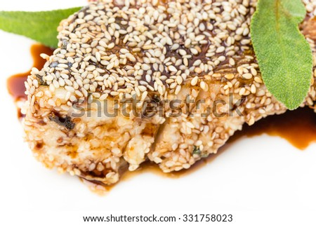 Perch fillet with tomato and avocado salsa covered with sesame seeds. Macro. Photo can be used as a whole background. - stock photo