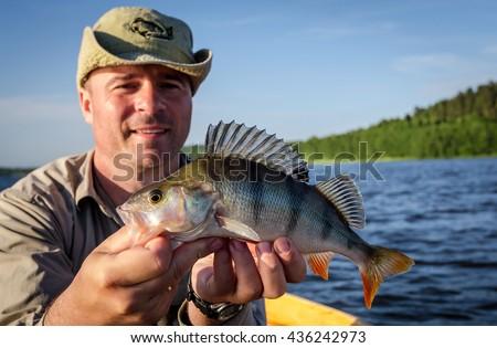 Perch fishing in summer lake - stock photo