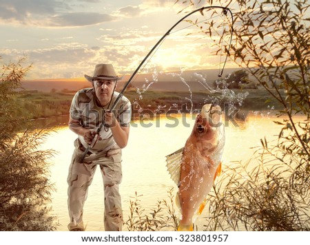 Perch. Man fishing in the river at sunset - stock photo