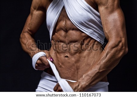 perfect abs - a female bodybuilder - stock photo