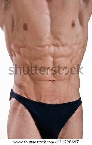 Perfect athletic male body isolated on white background - stock photo