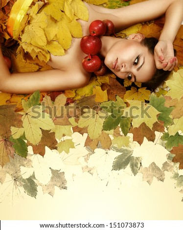 Perfect autumn beauty girl with maple leaves - stock photo