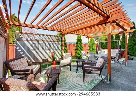 Perfect back yard including furnished patio with hot tub. - stock photo