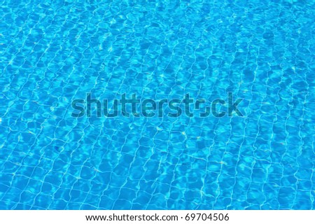 Perfect background - clear, pure and transparent water in swimming pool - stock photo