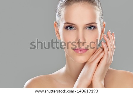 Perfect beauty, beautiful young woman, studio shot on nice gray background - stock photo