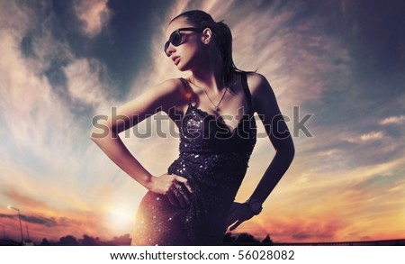 Perfect fashionable lady wearing sunglasses - stock photo