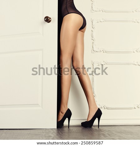 Perfect female legs in classical interior. Fashion art photo - stock photo