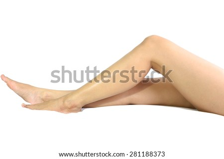 Perfect female legs in isolated laying on the bed in white background - stock photo